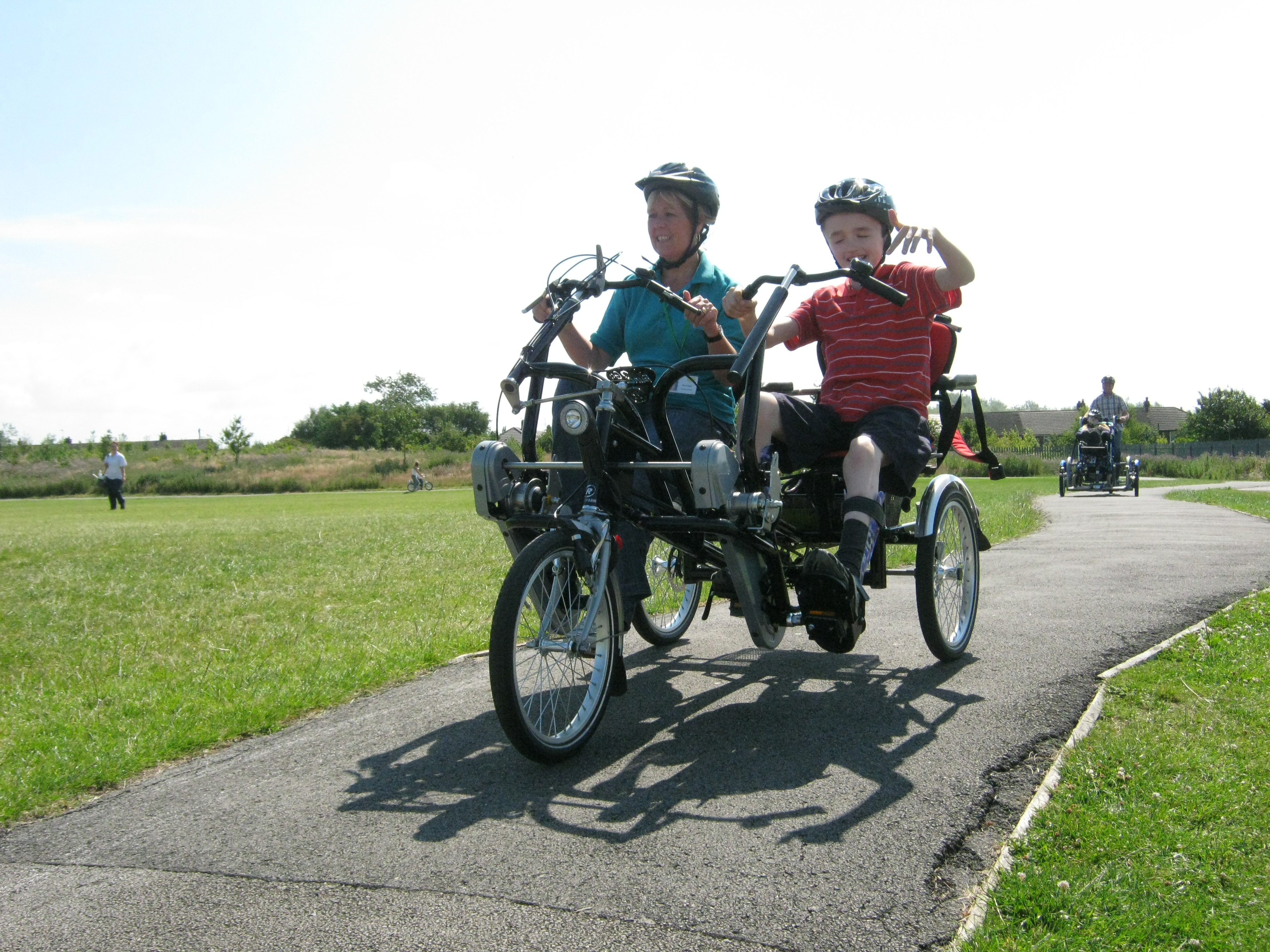 Adapted bike ride with parent and child