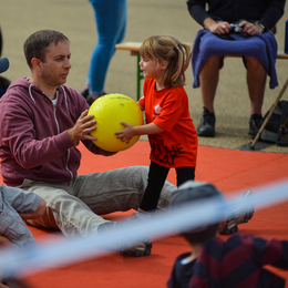 Family playing sitting volleyball listing
