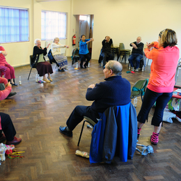 Older people doing an exercise class listing