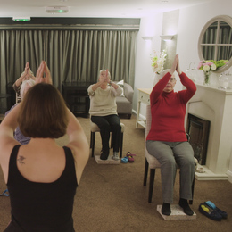 10 principles   presenter kris at a seated yoga session for older people listing