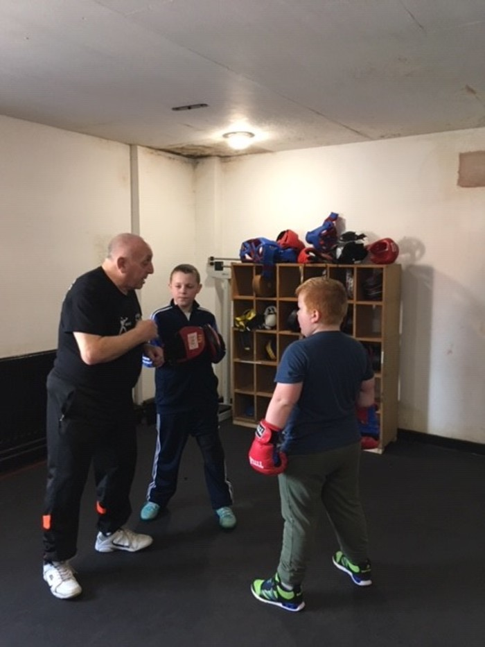 Bill coaching 2 youngsters at the Golden Gloves Community Event