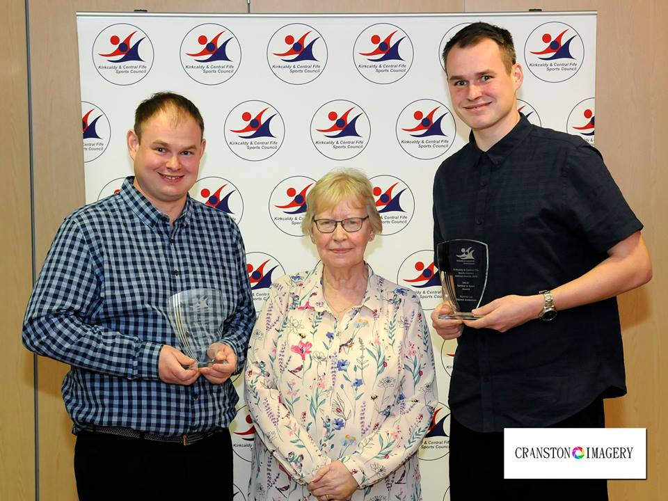 Robert and Stephen receiving their service to sport award